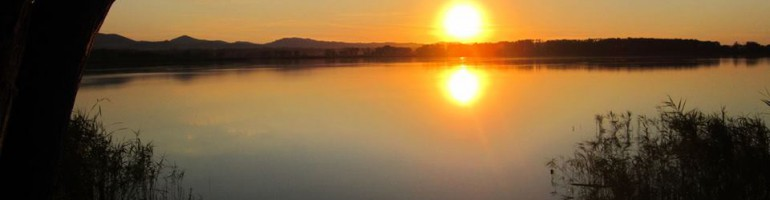 rossi-tramonto_lago
